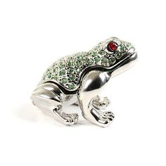 """""""Mini Trinket Box Silver #Frog With #Crystals Item No. KB00420A01 $24.49 This 1 1/4"""" x 1 1/4"""" x 1"""" miniature frog is a trinket box made out of pewter! This little frog opens up to reveal a tiny space for whatever you can find to put in there! This adorable frog has been silver plated, hand enameled, and decorated with many small green crystals that match the interior color. This froggie keepsake looks so cute anywhere you put him, and he also makes for a darling gift."""" Austrian Crystal, Small Boxes, Keepsake Boxes, Colorful Interiors, Trinket Boxes, Pewter, Silver Plate, Jewelry Box, Plating"""