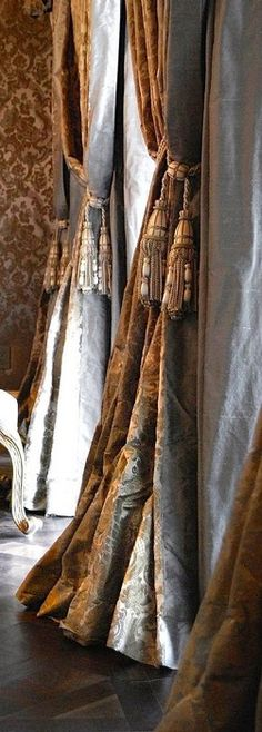 simple draperis in metallic silks and formal tiebacks. Beauty without high priced labor. available DesignNashville