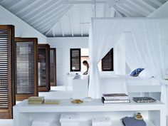 Beach house. Photos: Gaëlle Le Boulicaut - pool/guest house (vaulted beamed ceiling in white)