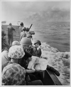 'Where Marines go, their pin-ups go' - marines approaching Japanese-held Tarawa view a picture of a pinup girl, November 1943 [[MORE]] Source