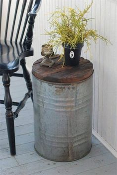 Add rustic, relaxed character to your farmhouse decor with this Salvaged Metal Drum Side Table. Made with recycled wood inset into an old galvanized metal drum, this unique side table has vintage industrial style that suits modern farmhouse style or casua Rustic Farmhouse, Farmhouse Style, Rustic Style, Rustic Elegance, Rustic Kitchen, Country Decor, Rustic Decor, Drum Side Table, Shabby Chic Stil