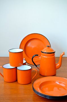 Vintage Set of Japanese Orange Enamelware Plates, mugs, and coffee/ tea pot