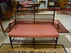 Elegant small 2 seater #sofa, #Regence, in blond #mahogany and #limewood inlays decor of baskets of flowers and foliage. #19th century. For sale on Proantic by Antiquités Robine.