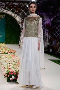 Varun Bahl indian designer runway couture 2016 collection online. an ivory frill hem georgette anarkali with embroidered sleeves. It comes along with a gold fully embellished tasseled net top and a matching stretchable net churidar.Shop now on www.carmaonlineshop.com #ICW2016 #VarunBahl #carmaonline #couture #romantic #floral #lehenga #embroidery #designer #delhi #wedding #whimsical #shoponline