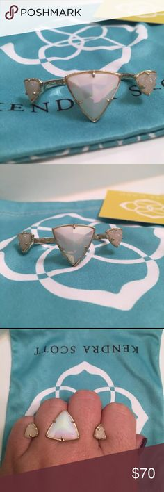 Kendra Scott Rachael Double Ring This Kendra Scott double ring is a statement piece, everyone will ask you about it and compliment you!! I've worn it a few times but it's in great shape! It is size M/L however, it is easily adjustable for any size fingers! There are very tiny tarnished on the under side, you will never see them while wearing it! I'm happy to answer any questions and entertain offers! Kendra Scott Jewelry Rings