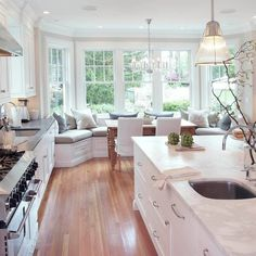 A new kitchen and family room for the back of a classical white stucco house, built in 1905.