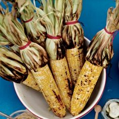 Grilled Corn with Mango-Habanero Butter: Food Network star Bobby Flay likes to cook corn on the cob with the husk tied back into a kind of handle. He soaks the bundle in cold water before it goes on the grill for two reasons: It steams the kernels a little, making them tender; and it prevents the husks from burning.