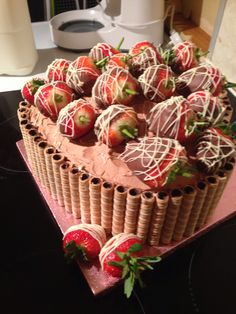 Chocolate sponge with white and milk chocolate buttercream and chocolate dipped strawberries! Made for my fiance's 25th birthday