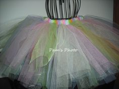 """18"""" inch elastic waste band. Tulle is 10 - 12 inches in length. Tulle colors are, light pink, light blue, white, lime green, orange, lavender, light yellow."""