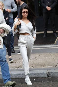 Kourtney Kardashian wearing Adidas Yeezy Calabasas Powerphase Sneakers and Dorothee Schumacher Cropped Cardigan