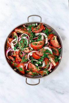 Mediterranean Fresh Herb Tomato Salad | The Mediterranean Dish. Tomatoes and red onions with fresh parsley and dill, doused in citrus and olive oil. Vegan. Gluten-free. Click the image for the recipe and visit TheMediterraneanDish.com for more healthy recipes!