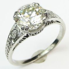 Peacock: This well proportioned ring absolutely nails the details, so it is elegant as well as fascinating. Ca.1910. Maloys.com