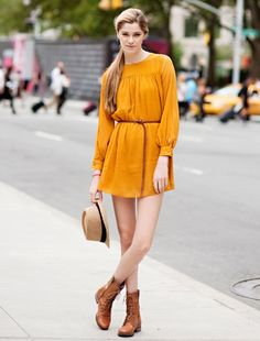 Mustard dress, thin belt, combat boots and panama.