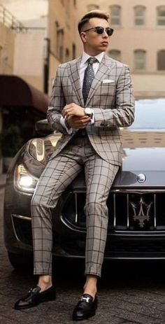 - with a beige brown windowpane suit with white button up shirt gray silk patterned tie ray ban sunglasses silver watch white pocket square lapel knot black loafers on a Maserati - - Mens Casual Suits, Classy Suits, Stylish Mens Outfits, Mens Fashion Suits, Stylish Clothes For Men, Suit For Men, Mens Suits Style, Men In Suits, Terno Slim