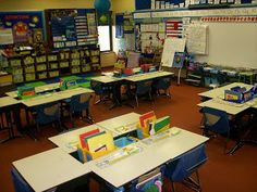 """One teacher's solution to add storage space in a table-based classroom. She built the cubbies between the desks to store each child's books and folders. Note: she built these herself, in her """"free"""" time."""