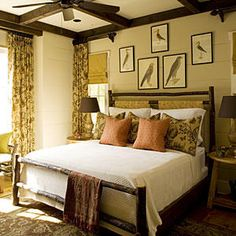 Master Bedroom - Best New Cottage: Interiors - Southernliving. Light-drenched window nooks, exposed timber beams, and mountain cabin-inspired furniture make Cow Rock Cottage's master bedroom a retreat unto itself. Antique prints of regional wildlife, along with floral-themed drapes, also reference the home's forested location.