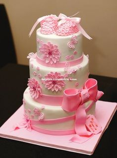 love the fondant bow on this baby shower cake