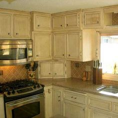 Appliance garage in the corner - no clutter on the counters - great idea!