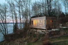 Sunset Cabin by Taylor Smyth Architects is a contemporary structural retreat just nestled above Lake Simcoe.