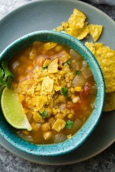 Slow cooker chickpea tortilla soup which can be assembled ahead of time and stored in the fridge or freezer. Dump into the slow cooker when you're ready.