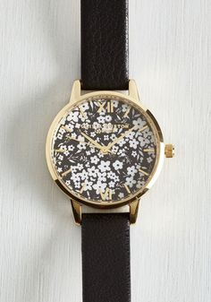 Floral Presentation Watch. On deck to present your studies to the class, you glance at this floral watch by Olivia Burton and feel your confidence grow! #black #modcloth