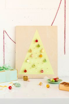 Add a modern twist to your holidays this year with a DIY: Modern Christmas Ornament Advent Calendar.