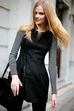 Striped long-sleeved t-shirt under sleeveless dress.