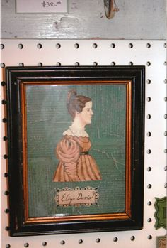 """1830 style watercolor portrait of a Lady, """"Eliza"""" by Steve Shelton.  Cut out and mounted to antique book pages with a color wash and hand painted label in a period frame.  At Whitehorse Antiques, Rocheport, Mo.  (SOLD!)"""