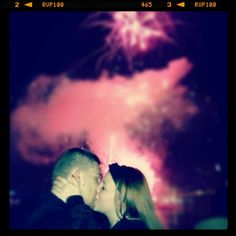Adorable new years kiss with fireworks in the background. Try and capture this precious moment <3