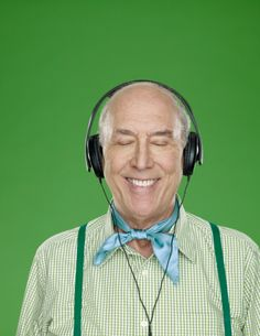 Stock Photo : Senior man wearing headphones, smiling, studio shot