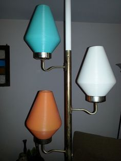 When my mom redecorated our livingroom in the late 60's she bought a lamp very similar to this. Only difference was the individual shades were on a swivel so that you could redirect the light..