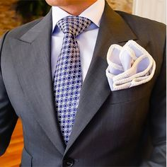 Not usually a fan of a flared pocket square, but it adds excitement to this suit-tie combo.