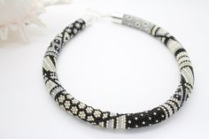 Beaded Necklace - Silver Glamour    Elegant beaded necklace will attract attention immediately regardless of your outfit style. Light sparkle of tiny