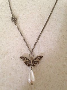 Hey, I found this really awesome Etsy listing at https://www.etsy.com/listing/234604912/bronze-butterfly-charm-necklace