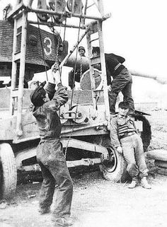 Crews working to remove or install a Tiger 1 turret using a overhead Crane system while a slacker does nothing during the process. Tiger Ii, Tiger Tank, Tank Destroyer, Model Tanks, Military Pictures, Ww2 Tanks, Military Diorama, German Army, Panzer