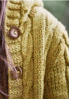 This looks like the Central Park Hoodie in yellow :)  I've knitted one i grey and I loooove it. Great pattern.