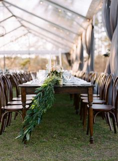 Jacobean Farm Tables and Bentwood Chairs for rent at this amazing Lake Oconee Wedding Tent