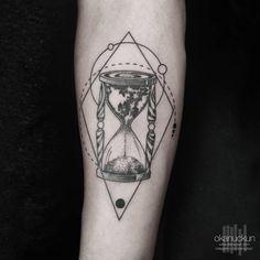 Worldly hourglass tattoo by Okan Uckun