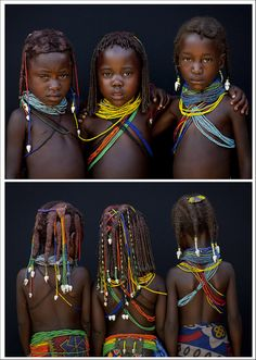 Mwila tribe children - Angola    These little girls from the Mumuhuila tribe live near Chibia, in the south of Angola. They wear the traditional hairstyle and the big necklace. The necklace shows if they are teens or not. They still are children as the necklace is simple, with beads.