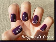 Purple  rhinestones manicure