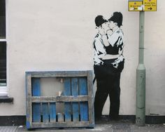 Kissing Coppers, by Banksy
