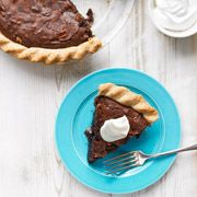 Tar Heel Pie - from the southern states; North Carolina.  Rich brownie filling is thick and dark as the state's namesake resource.  Woman's Day mag 2012
