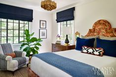 """""""The daughter wanted a room with black and navy, her favorite color combination,"""" says Woodbery. """"We had a custom headboard made in a Ralph Lauren cut velvet that looks like a Persian rug. It makes a statement and pulls the palette together."""""""