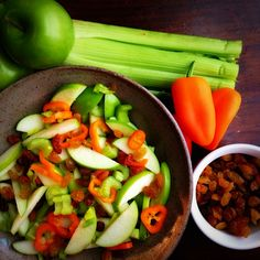 Mix together two small sliced granny smith apples, two chopped celery stalks, three small orange snacking-peppers, and a handful of golden raisins. Sprinkle lemon juice on top to keep the apples bright.