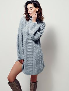 Mini Cable Sweater Dress   Cozy cable knit mini sweater dress featuring a ribbed turtleneck. Rounded hem and wide sleeves.