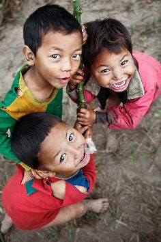 While on a trek in Northern Laos, I decided one morning to awake early and explore the village. These three little boys were very cheeky, playful and energetic. I gave them the attention they sought, and had fun capturing their spirit. Beautiful Smile, Beautiful Children, Life Is Beautiful, Beautiful Babies, We Are The World, People Around The World, Little People, Little Boys, Bless The Child