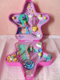 Polly Pocket dolls. Not those crappy new ones with the rubber outfits, but the actual dolls that were 1 centimeter tall and fit into little houses like this one. I used to have a beach resort one shaped like a shell, a garden one shaped like a flower, a square one that was a horse stable, and a bunch of others I don't remember :P