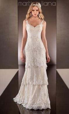 Martina Liana 597 10: buy this dress for a fraction of the salon price on PreOwnedWeddingDresses.com