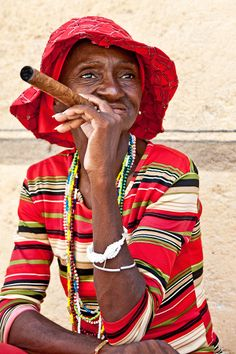 PLACES WE LOVECuba We like her style.Photograph byHal Robert Myers.