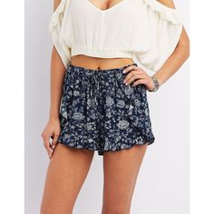 Charlotte Russe Floral Print Ruffle Shorts ($19) ❤ liked on Polyvore featuring shorts, navy combo, ruffle shorts, shiny shorts, flounce shorts, frilly shorts and navy blue shorts